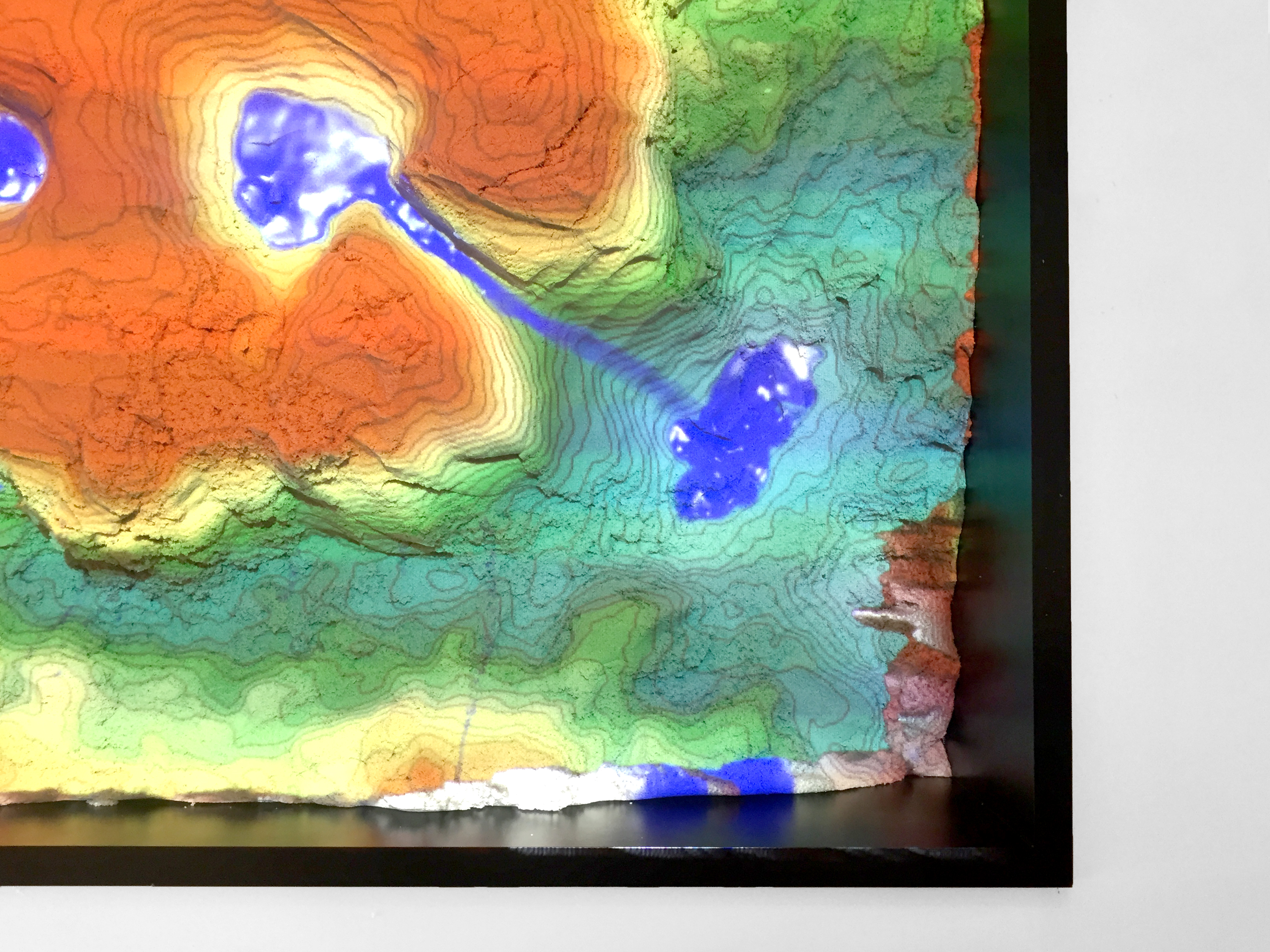 With the Augmented Reality Sandbox, playing with sand is a lot of fun for adults, too.